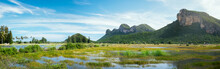 Beautiful Outdoor Panoramic Landscape Of Mountains And Big Green Lake In Sam Rai Yot Region. Exotic Nature Photography Of Thailand