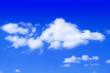 Leinwandbild Motiv The blue sky with clouds, background.Blue sky background with tiny clouds