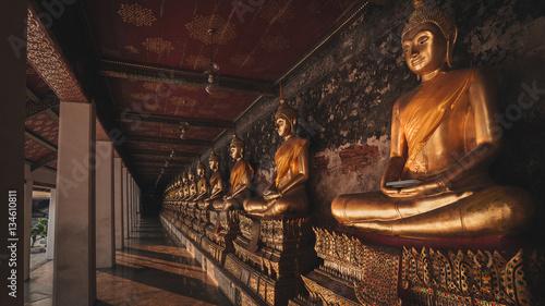 Wall Murals Temple Yellow golden buddha at Wat Suthat Thepwararam in Bangkok,Thailand