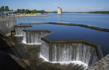 Waterfall At Manmade Lake In Strathclyde Country Park In Lanarkshire Scotland.