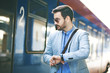 Businessman on rail station