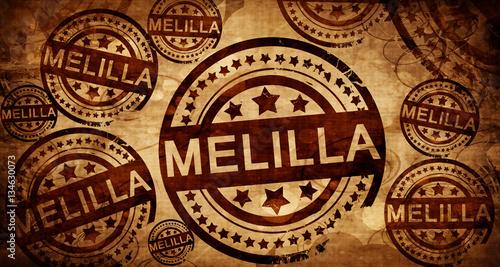 Melilla, vintage stamp on paper background