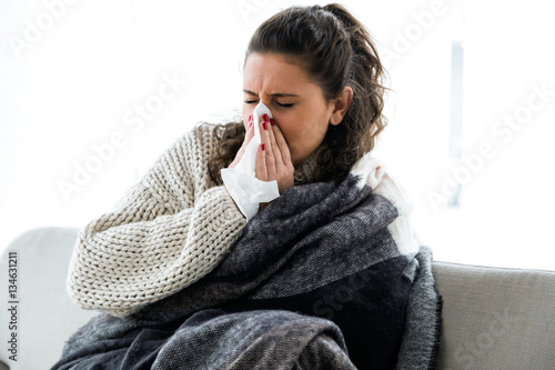 Fotografie, Tablou  Illness young woman sneezing in a tissue.