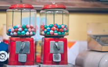 Collectible Antique Bright Multi-color Plastic Balls In A Transparent Glass Box With The Coin Slot Machine Dispenser In Vintage Style.