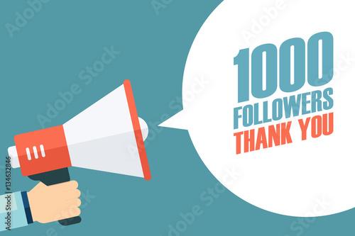 Vászonkép Male hand holding megaphone with 1000 followers, Thank You speech bubble