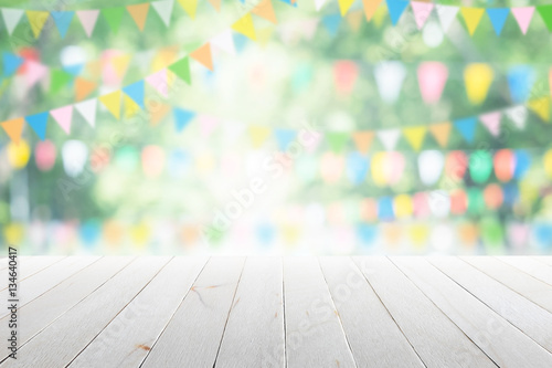 Fotobehang Tuin Empty wooden table with party in garden background blurred.