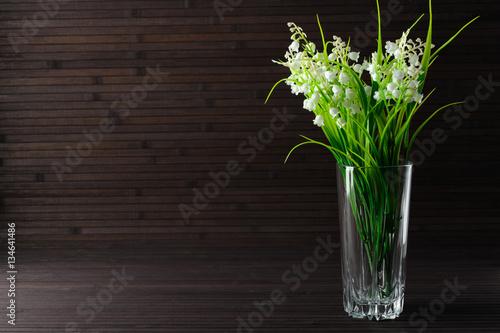 Staande foto Lelietje van dalen Bouquet artificial lily of the valley in a glass