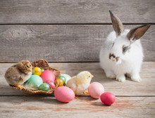 Chicken And Rabbit With Easter Eggs On Wooden Background
