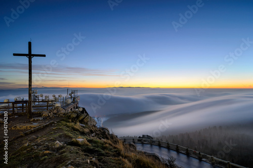 Poster Natuur Amazing view from Jested mountain peak during cold winter day. Beautiful foggy morning, Czech republic.