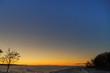 Winter sunset over snowy field.