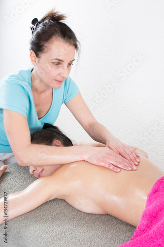Young woman having massage by professional specialist Canvas Print