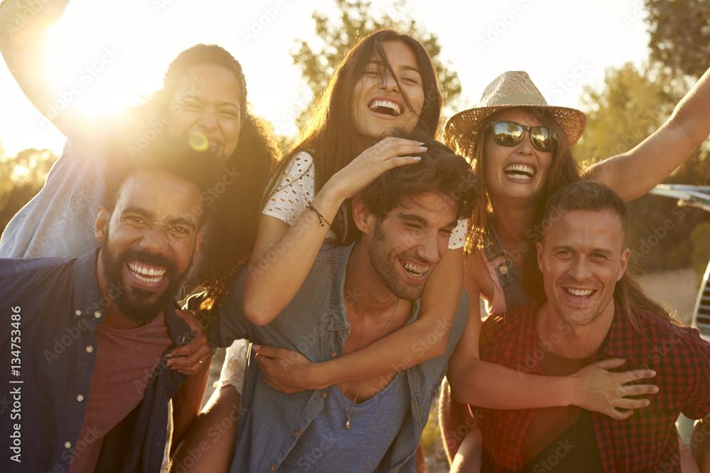 Fototapety, obrazy: Three couples having fun piggybacking at sundown