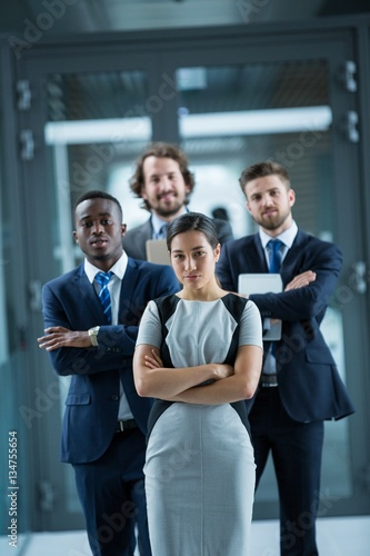 Fototapety, obrazy: Confident businesspeople standing in office