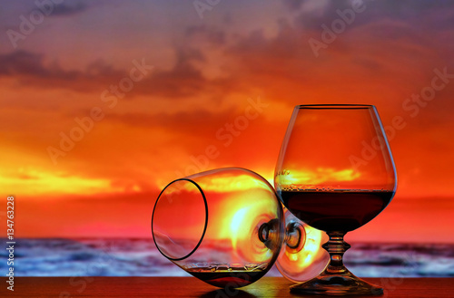 In de dag Vintage cars Brandy glass on sunset background