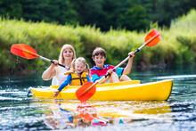 Family Enjoying Kayak Ride On ...