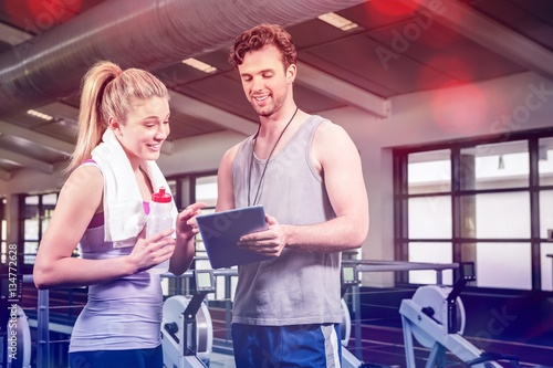 Woman talking to trainer after workout
