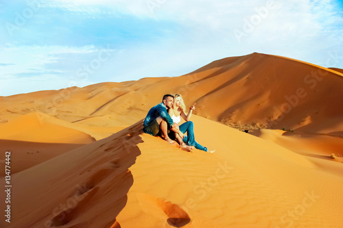 Canvas Prints Morocco Loving couple in the Sahara Desert. Morocco.