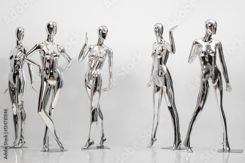 many fashion shiny female mannequins for clothes. Metallic manne Wallpaper Mural
