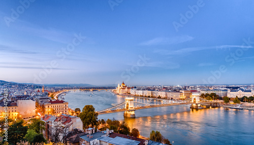 Picturesque dusk scenery of Budapest historical downtown over Danube river delta. Budapest is popular city for romantic trip.