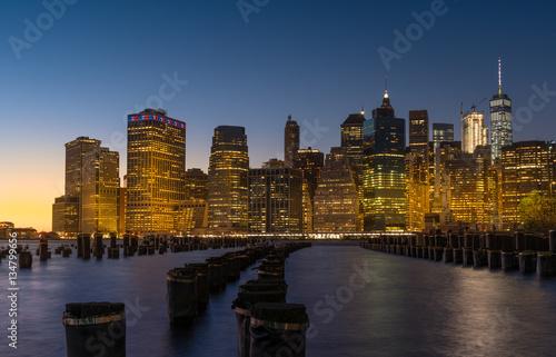 Manhattan skyline at night, viewed from Brooklyn Bridge Park Poster