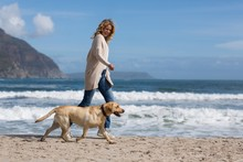 Woman Walking With Her Dog On ...