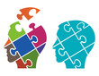 Puzzle male heads symbolizing Psychology. Two Puzzle heads silhouettes symbolizing Psychology, psychological problems.Vector available.