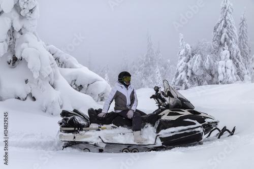Fotografie, Obraz  Woman on a snowmobile