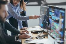 Group Of Brokers Analysing Stock Martek Perfprmance On Their Mon