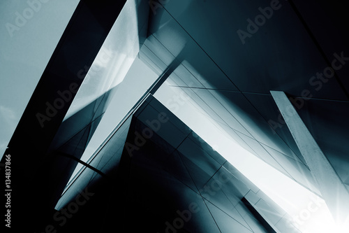 Wide angle abstract background view of steel light blue high ris Fototapeta