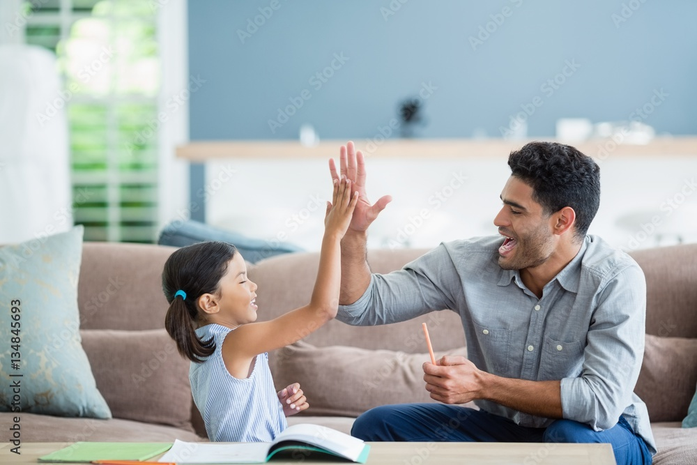 Fototapety, obrazy: Father giving high five to his daughter