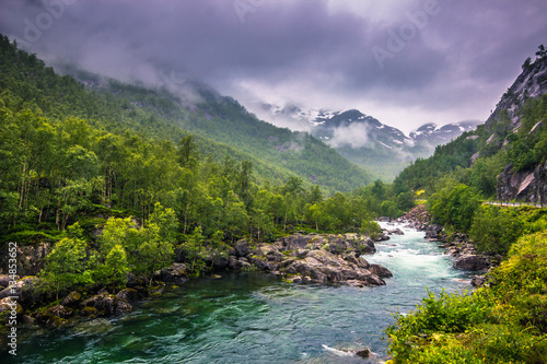 Poster Oceanië July 21, 2015: Small river in the norwegian countryside, Norway