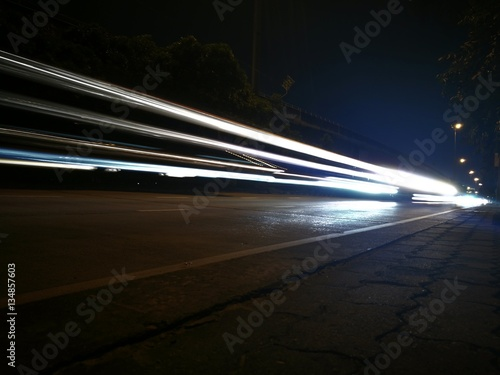 Foto op Aluminium Nacht snelweg Car light trails on the road, movement in Thailand.