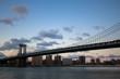 Manhattan bridge over the river in the evening