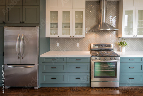 Fotografija Modern Kitchen with Teal Base Cabinets