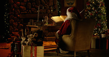 Santa Claus Works At His Desk,...