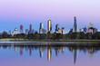 Melbourne Australia Skyline viewed from Albert Park Lake at Sunr