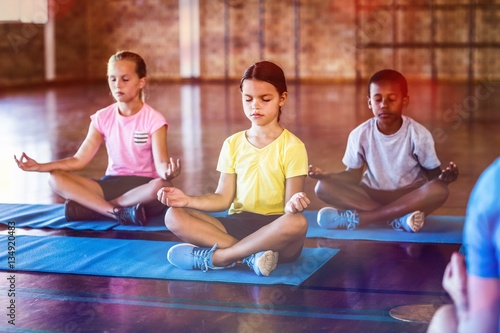 Door stickers Yoga school School kids meditating during yoga class