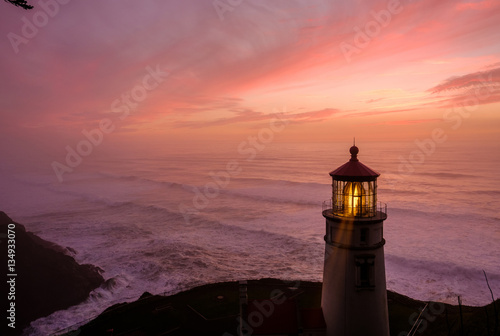 Foto op Canvas Vuurtoren Heceta Head Lighthouse at sunset, built in 1892