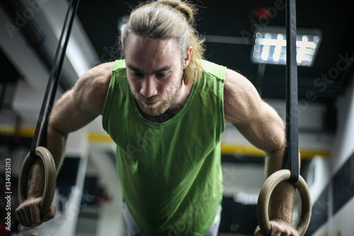 Fotografie, Obraz  Attractive fit man working out at the gym.