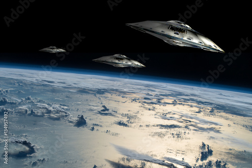 Photo A fleet of flying saucers approach Earth - Elements of this image furnished by NASA
