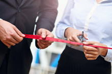 Businesspeople Cutting The Ribbon