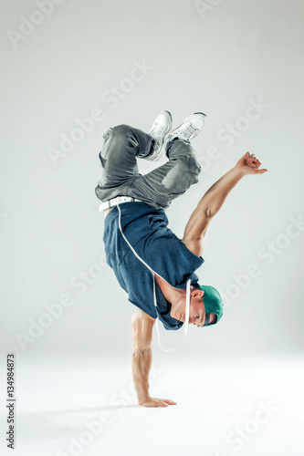 Cuadros en Lienzo Man break dancer on white studio background