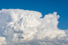 Cumulus Clouds Forming On A Bl...