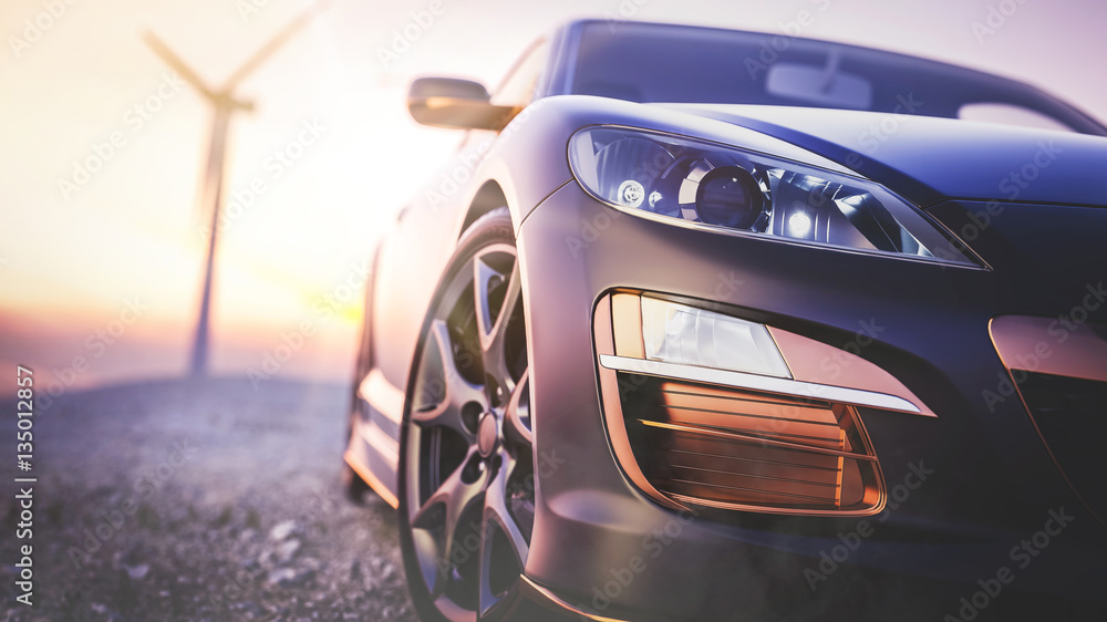 The image in front of the sports car scene behind as the sun goi