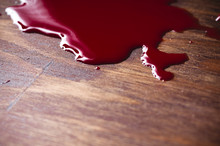 A Puddle Of Blood On A Wooden ...