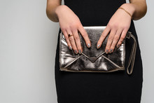 Fashion Woman Hold Silver Clutch In Hand Bag