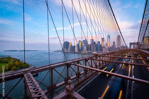 Traffic on the Brooklyn Bridge in New York. Blurred cars driving from Lower Manhattan.