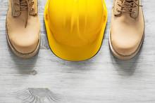 Pair Of Waterproof Boots Building Helmet On Wooden Board Constru