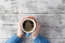 Big Mug Of Coffee In Hands