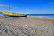 Old blue-yellow wooden boat stranded on the beach. Çirali-Turkey. 0358